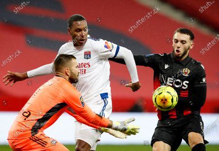 Amine Gouiri (R) of OGC Nice with Marcelo (C) of Olympique Lyon and Anthony Lopes (L) of Olympique Lyon in action during the French Ligue 1 soccer match, OGC Nice vs Olympique Lyon, at the Allianz Riviera stadium, in Nice, France, 19 December 2020.