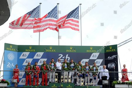 (L to R): Second placed Giancarlo Fisichella (ITA) / Toni Vilander (FIN) / Matteo Malucelli (ITA), RISI Competizione, Race winners Joey Hand (USA) / Dirk Muller (GER) / Sebastien Bourdais (FRA), Ford Chip Ganassi Team UK and Third placed Ryan Briscoe (AUS) / Richard Westbrook (GBR) / Scott Dixon (NZL), Ford Chip Ganassi Team UK Ford GT celebrate on the podium at Le Mans 24 Hours, Race, Le Mans, France, 18-19 June 2016.