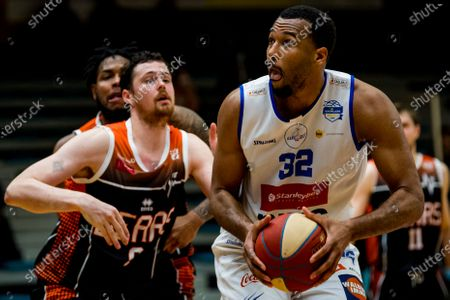 Leuven's Jonas Delalieux and Mechelen's Trevor Thompson fight for the ball during a basketball match between Kangoeroes Mechelen and Leuven Bears, Saturday 19 December 2020 in Mechelen, on day 5 of the 'EuroMillions League' Belgian first division basket championships, in the group A.