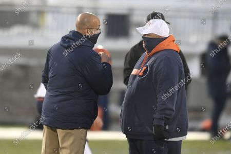 Penn State head coach James Franklin talks with Illinois interim head coach Rod Smith before an NCAA college football game in State College, Pa., on