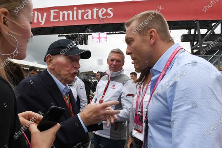 Chris Hoy (GBR) on the grid with John Surtees (GBR) at Formula One World Championship, Rd10, British Grand Prix, Race, Silverstone, England, Sunday 10 July 2016.