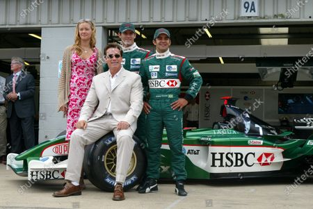 Stock Picture of (L to R): T3 co-star Kristanna Lokken,  T3 star Arnold Schwarzenegger (AUT), Mark Webber (AUS) Jaguar and Antonio Pizzonia (BRA) Jaguar. Formula One World Championship, Rd11, British Grand Prix, Race Day, Silverstone, England, 20 July 2003. DIGITAL IMAGE