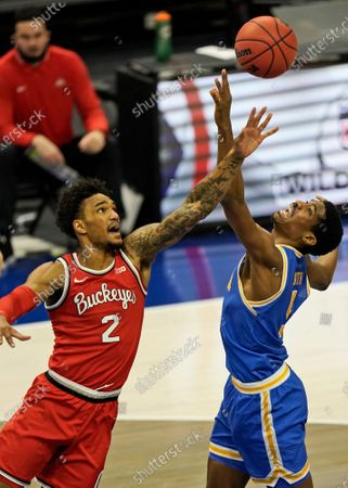 Ohio State's Musa Jallow (2) and UCLA's Chris Smith (5) battle for a rebound in the first half of an NCAA college basketball game, in Cleveland