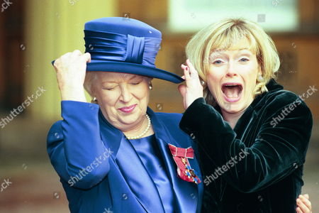 June Whitfield's Daughter Suzy Aitchison Sees The Funny Side Of Things As She Almost Knocks Her Mother's Hat Off After She Received The Cbe From Prince Charles At Buckingham Palace.