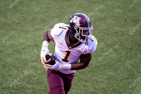 Minnesota running back Cam Wiley (1) runs against Wisconsin during the first half of an NCAA college football game, in Madison, Wis