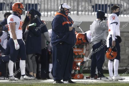 Illinois interim head coach Rod Smith watches the action during the first quarter of an NCAA college football game against Penn State in State College, Pa., on