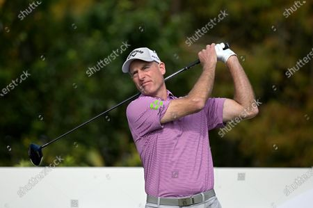 Jim Furyk watches his tee shot on the first hole during the first round of the PNC Championship golf tournament, in Orlando, Fla