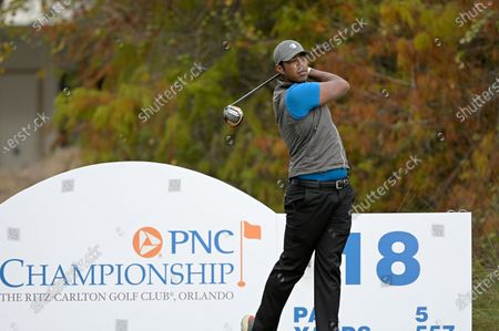 Qass Singh, son of golfer Vijay Singh, tees off on the 18th hole during the first round of the PNC Championship golf tournament, in Orlando, Fla