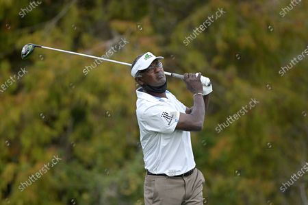 Vijay Singh, of Fiji Islands, watches his tee shot on the 18th hole during the first round of the PNC Championship golf tournament, in Orlando, Fla