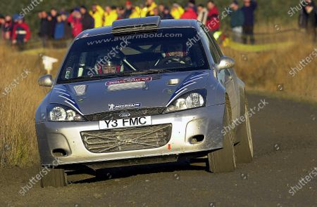 Anthony Warmbold (GER) / Gemma Price (GBR) Ford Focus RS WRC 02. World Rally Championship, Rd 14, Rally of Great Britain, Wales, Day 1, 7 November 2003. DIGITAL IMAGE