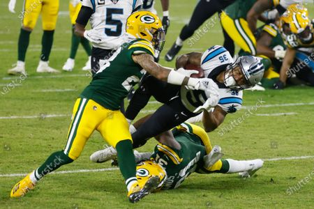 Stock Picture of Green Bay Packers' A.J. Dillon stops Carolina Panthers' Rodney Smith during the first half of an NFL football game, in Green Bay, Wis