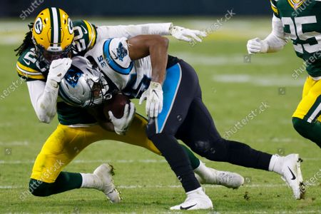 Green Bay Packers' Kevin King stops Carolina Panthers' Rodney Smith during the second half of an NFL football game, in Green Bay, Wis
