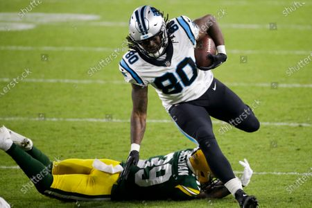 Carolina Panthers' Ian Thomas gets past Green Bay Packers' Chandon Sullivan during the first half of an NFL football game, in Green Bay, Wis