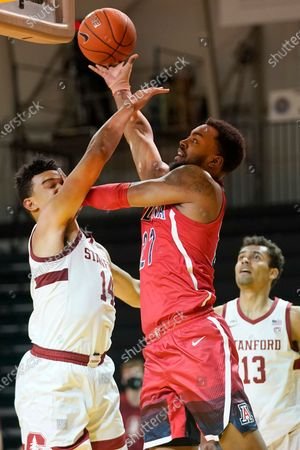 Arizona forward Jordan Brown, middle, shoots between Stanford forward Spencer Jones, left, and forward Oscar da Silva (13) during the first half of an NCAA college basketball game in Santa Cruz, Calif