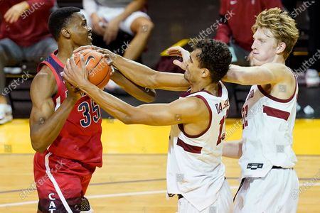 Arizona center Christian Koloko, left, is defended by Stanford forward Oscar da Silva, middle, and James Keefe during the first half of an NCAA college basketball game in Santa Cruz, Calif