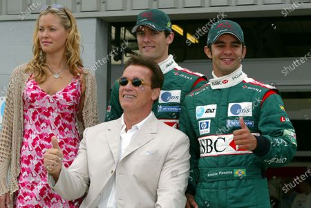 Stock Photo of (L to R): T3 co-star Kristanna Lokken,  T3 star Arnold Schwarzenegger (AUT), Mark Webber (AUS) Jaguar and Antonio Pizzonia (BRA) Jaguar. Formula One World Championship, Rd11, British Grand Prix, Race Day, Silverstone, England, 20 July 2003. DIGITAL IMAGE