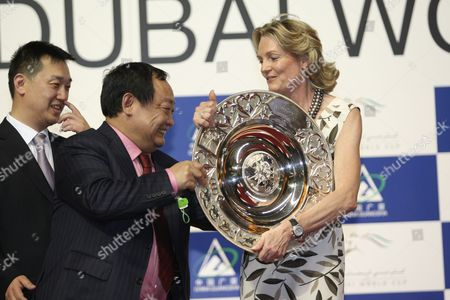 Madeleine Astrid Gurdon, Baroness Lloyd Webber, owner of Dar Re Mi from Britain receives her trophy after winning the Dubai Sheema Classic race during the World Cup