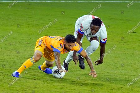 Tigres midfielder Javier Aquino, left, collides with Olimpia midfielder Marvin Bernardez, right, going for the ball during the first half of a CONCACAF Champions League soccer match, in Orlando, Fla