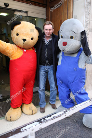 Phillip Glenister with Sooty and Sweep