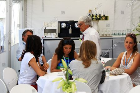 Bernie Ecclestone (GBR) CEO Formula One Group (FOM) talks with Daniella Helayel (BRA) Fashion Designer for label ISSA and Linn Gothall (SWE) British Airways Senior First Officer. Formula One World Championship, Rd5, Spanish Grand Prix, Qualifying Day, Barcelona, Spain, Saturday 12 May 2012.