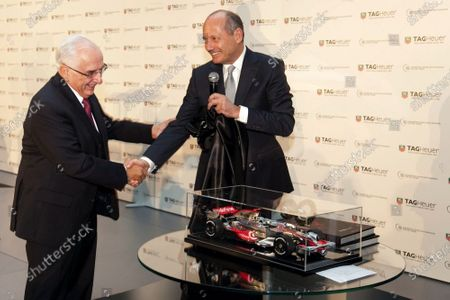 Stock Picture of (L to R): Jack Heuer, Honorary Chairman TAG Heuer shakes hands with Ron Dennis (GBR) McLaren. TAG Heuer Celebrate 150 Years and 25 Years with McLaren, McLaren Technology Centre, Woking, England, 3 December 2009.