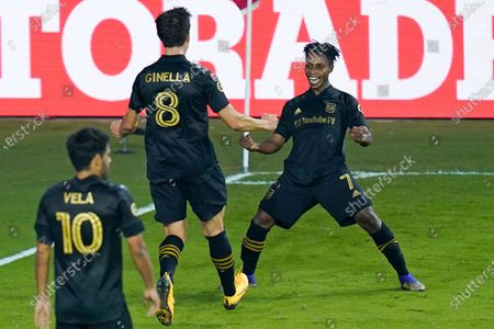 Los Angeles FC forward Latif Blessing (7) celebrates after scoring a goal against Club America with teammates midfielder Francisco Ginella (8) and forward Carlos Vela (10) during the second half of a CONCACAF Champions League soccer match, in Orlando, Fla