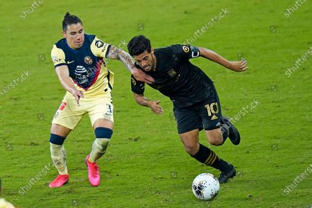 Stock Image of Los Angeles FC forward Carlos Vela (10) moves the ball past Club America defender Jorge Sanchez (3) during the second half of a CONCACAF Champions League soccer match, in Orlando, Fla