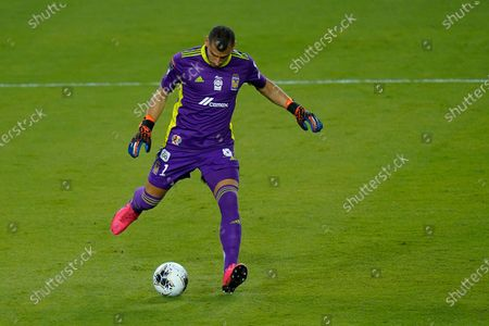 Tigres goalkeeper Nahuel Guzman (1) clears the ball during the first half of a CONCACAF Champions League soccer match against Olimpia, in Orlando, Fla