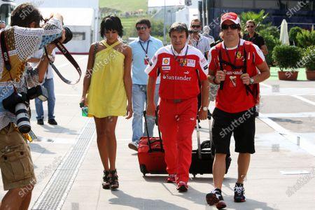 Fernando Alonso (ESP) Ferrari with his wife Raquel del Rosario (ESP) and his trainer Fabrizio Borra (ITA)  Formula One World Championship, Rd 12, Hungarian Grand Prix, Qualifying Day, Budapest, Hungary, Saturday 31 July 2010.