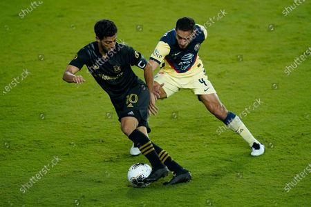 Los Angeles FC forward Carlos Vela (10) gets past Club America defender Sebastian Caceres (4) during the second half of a CONCACAF Champions League soccer match, in Orlando, Fla