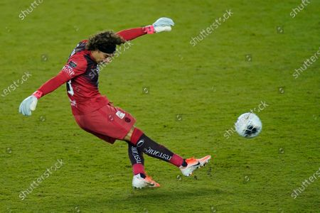 Club America goalkeeper Guillermo Ochoa (13) kicks during the second half of a CONCACAF Champions League soccer match against Los Angeles FC, in Orlando, Fla