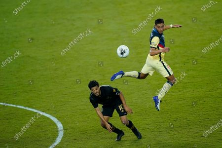 Club America defender Sebastian Caceres goes up for a header against Los Angeles FC forward Carlos Vela (10)during the second half of a CONCACAF Champions League soccer match, in Orlando, Fla