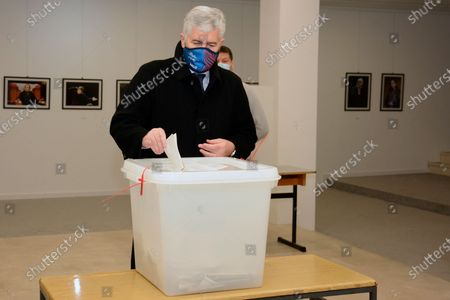 Stock Photo of Dragan Covic of the Croatian Democratic Union (HDZ) casts his ballot for the local elections at a polling station in Mostar, Bosnia, . Divided between Muslim Bosniaks and Catholic Croats, who fought fiercely for control over the city during the 1990s conflict, Mostar has not held a local poll since 2008, when Bosnia's constitutional court declared its election rules to be discriminatory and ordered that they be changed