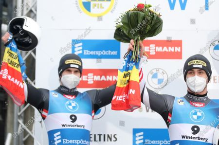 Thomas Steu and Lorenz Koller of Austria celebrate the second place on the podium after the Men's Luge World Cup Doubles Sprint Race in Winterberg, Germany, 20 December 2020.