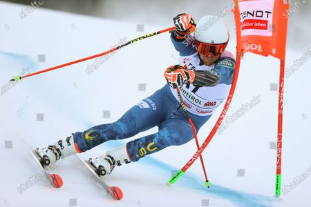 United States' Ted Ligety powers past a gate as he speeds down the course during an alpine ski, men's World Cup giant slalom in Alta Badia, Italy, Sunday, Dec.20, 2020