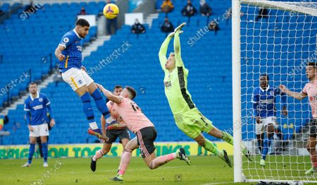 Brighton's Jose Izquierdo heads the ball to hit the cross bar during the English Premier League soccer match between Brighton and Hove Albion and Sheffield United at the American Express Community Stadium in Brighton, England