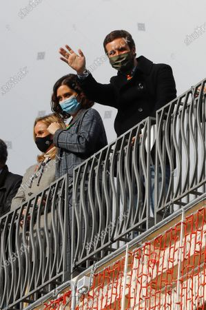 Leader of Spanish People's Party (PP), Pablo Casado (R), and Madrid's regional President, Isabel Diaz Ayuso (C), greet people taking part in a protest against the LOMLOE ('Organic Law of Modification of the Organic Law of Education'), popularly known as 'Ley Celaa', in downtown Madrid, Spain, 20 December 2020. Thousands of vehicles took part in the demonstration to show their rejection to the LOMLOE educational reform, which is expected to be approved on 23 December in the Senate, media reported.