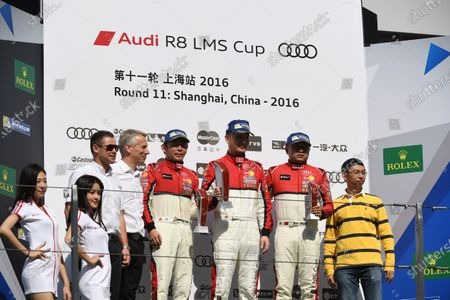 Tom Kristensen (DK) Audi Sport Ambassador & coach, Rene Koneberg (GER) Managing Director Audi Hong Kong & Chairman of the Steering Committee for the Audi R8 LMS Cup, Jeffrey Lee (TWN) Team Audi Volkswagen Taiwan 2nd Position, Anthony Liu (CHN) Absolute Racing 1st Position & Sun Jing Zu (CHN) Absolute Racing 3rd Position celebrate on the podium at Audi R8 LMS Cup, Rd11 and Rd12, Shanghai International Circuit, Shanghai, China, 4-5 November 2016.