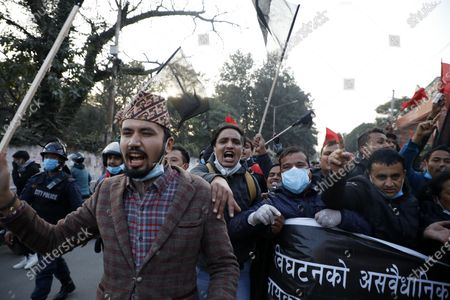 Nepalese people take part in a protest against the endorsement of the current Nepalese government in Kathmandu, Nepal, 20 December 2020. According to media reports, Nepalese Prime Minister K.P. Sharma Oli, in response to challenge from party rivals, recommended the dissolution of the Parliament and called for general election during an emergency Cabinet meeting held on the day. The decision has been ratified by President Bidhya Devi Bhandari, who has called a two-phase election to be held in April and May 2021, media added.