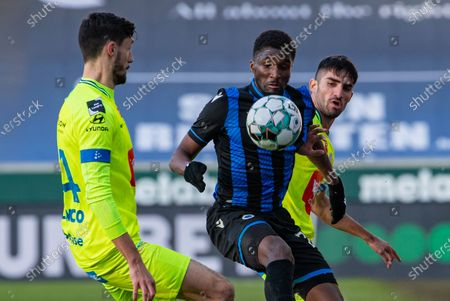 Gent's Tim Kleindienst, Club's Clinton Mata and Gent's Milad Mohammadi fight for the ball during a soccer match between Club Brugge KV and KAA Gent, Sunday 20 December 2020 in Brugge, on the seventienth day of the 'Jupiler Pro League' first division of the Belgian championship.