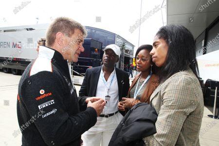 Dr. Aki Hintsa (FIN) McLaren team Doctor and Yamile Aldama (GBR) Triple Jumper. Formula One World Championship, Rd9, British Grand Prix, Race, Silverstone, England, Sunday 8 July 2012.