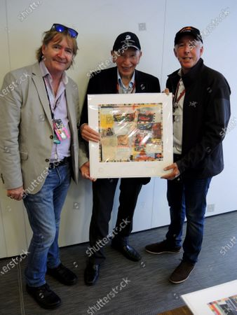 Keith Sutton (GBR) Sutton Images CEO and Mark Dickens (GBR) Artist present John Surtees (GBR) with his World Champions in Art print at Formula One World Championship, Rd10, British Grand Prix, Race, Silverstone, England, Sunday 10 July 2016.