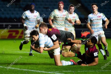 Francois Trinh-Duc of Racing 92 dives for the try-line despite the challenge of Alex Dombrandt and Ben Tapuai of Harlequins