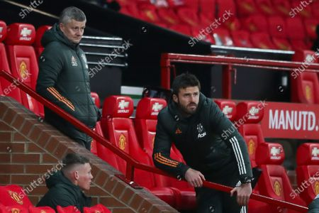 Manchester United's head coach Ole Gunnar Solskjaer (L) and Manchester United's assistant manager Michael Carrick (R) react during the English Premier League soccer match between Manchester United and Leeds United in Manchester, Britain, 20 December 2020.