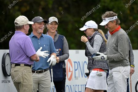 Tom Kite, left, his son David, Bernhard Langer, right, of Germany, and his daughter Jackie Langer John, second from right, laugh on the first tee during the final round of the PNC Championship golf tournament, in Orlando, Fla