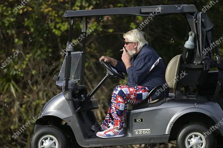 John Daly drives a cart after hitting from the first fairway during the final round of the PNC Championship golf tournament, in Orlando, Fla