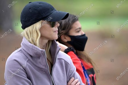 Elin Nordegren, left, and her daughter Sam Alexis Woods follow Tiger Woods and Charlie Woods on 18th hole during the final round of the PNC Championship golf tournament, in Orlando, Fla