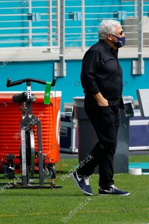 New England Patriots owner Robert Kraft walks the field before an NFL football game against the New England Patriots, in Miami Gardens, Fla