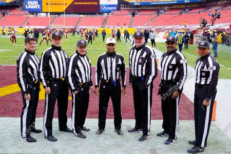 Stock Photo of From l-r., Jim Quirk, Kevin Codey, Paul King, Adrian Hill, Ed Camp, Keith Washington, Greg Steed, pose for their Officials Portrait before the start of an NFL football game between the Seattle Seahawks and Washington Football Team, in Landover, Md