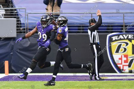 Baltimore Ravens linebacker Matthew Judon (99) celebrates safety sack with cornerback Marlon Humphrey (44) during the first half of an NFL football game against the Jacksonville Jaguars, in Baltimore